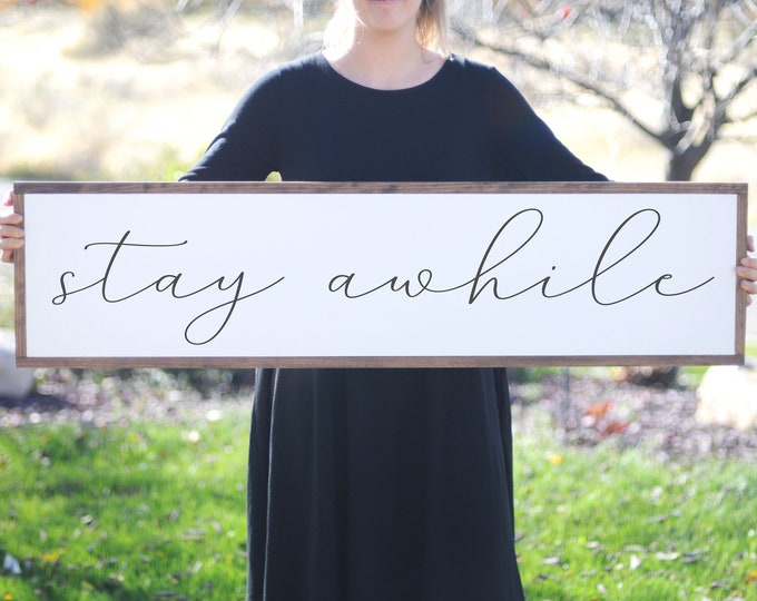Featured listing image: Stay Awhile Wood Sign, Farmhouse Decor Sign,  Family Room Large Sign,  Modern Farmhouse Wall Decor, Interior Design, Housewarming Gift