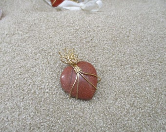 goldstone wrapped with gold tone wire
