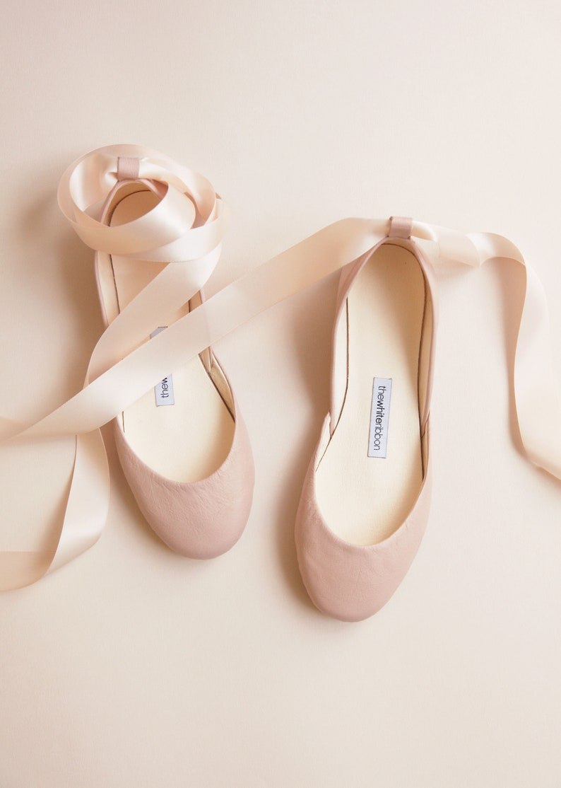 Only the prettiest blush pink nude shade of lovely on these handmade leather ballet flats from The White Ribbon on Etsy.