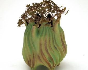 Matte green, gold & brown carved porcelain vessel with petals