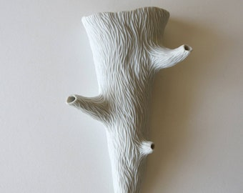 White porcelain twig wall pocket, unglazed, hand carved