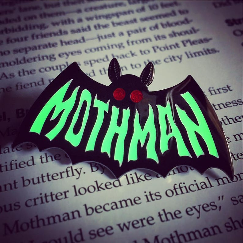 Mothman Symbol ENAMEL PIN - Glow in the Dark - Cryptozoology Tracking  Society moth red glitter eyes typography text lettering sign painting
