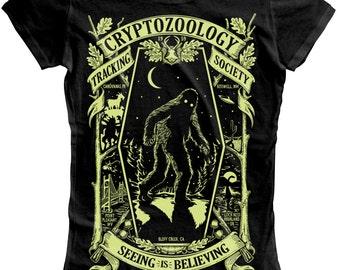 Cryptozoology Tracking Society - Black/Moon (Ladies) Glow in the Dark Sasquatch Bigfoot Mothman Chupacabra Loch Ness Monster Aliens UFO