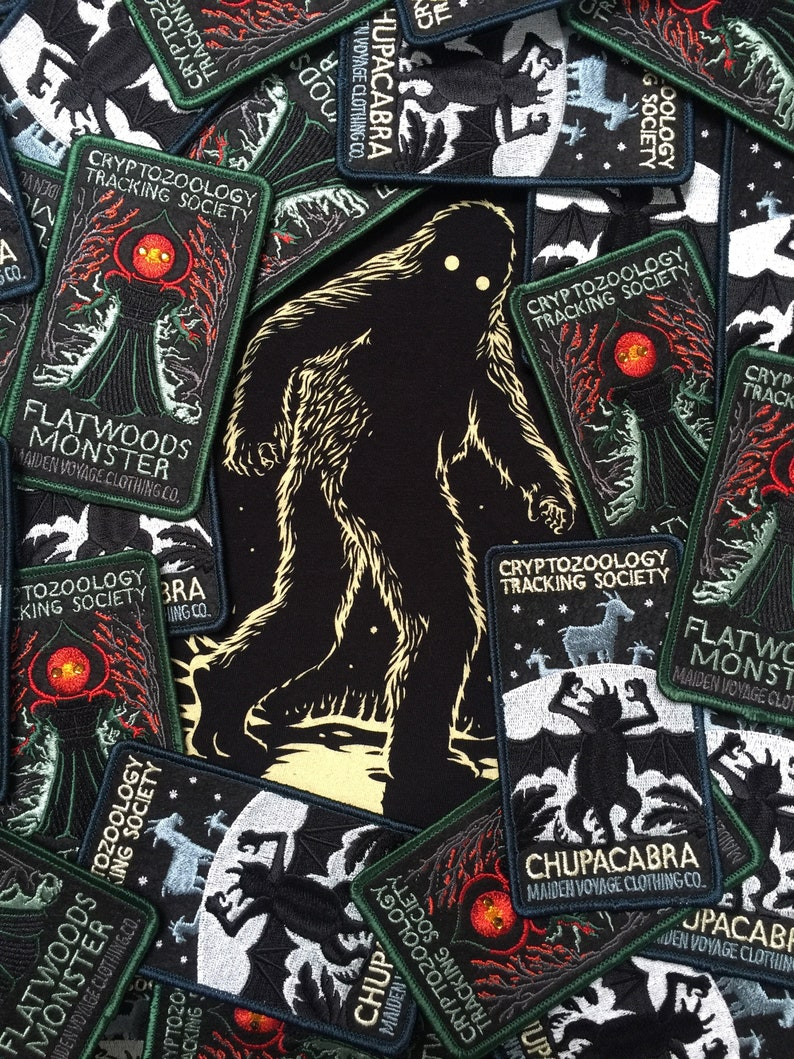 Cryptozoology Tracking Society - Black/Moon (Ladies) Glow Sasquatch Bigfoot  Mothman Chupacabra Loch Ness Monster Aliens UFO