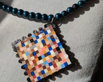 Pixelated pendant necklace