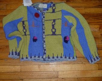 Abstract bird motif original hand knit cardigan by Scott Torkelson rowel spur buttons