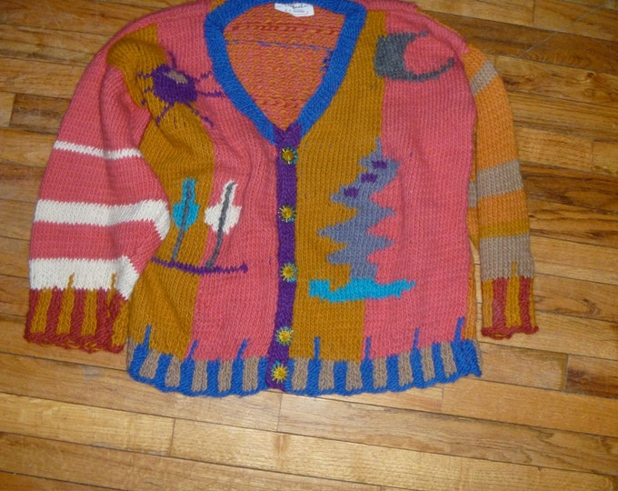 Flower bird motif original hand knit cardigan by Scott Torkelson rowel spur buttons