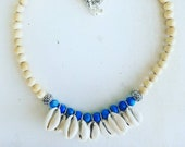 Cowrie Shells and Blue Ge...