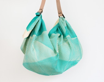a3097c03b790 Folded paper furoshiki bag (emerald green)   tan leather carry strap set