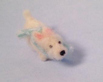 Westie wearing a light blue scarf miniature