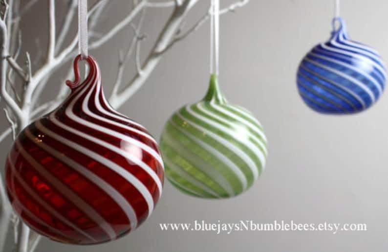 Red swirl blown glass ornament image 0