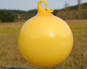 Yellow gumball blown glass ornament.