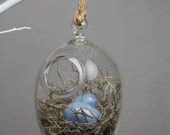 hand blown glass bird nest terrarium with two glass eggs