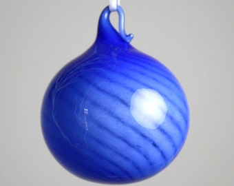 cobalt blue over white blown glass ornament with a twist