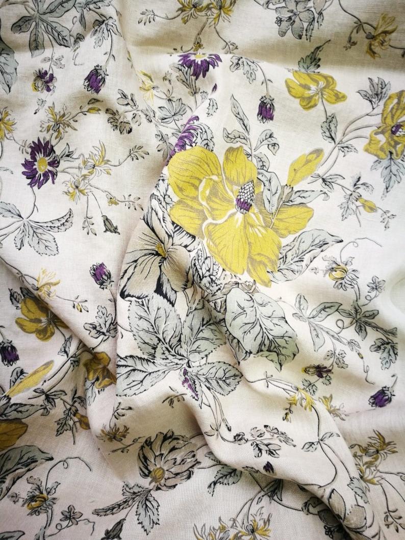 Pure linen fabric with print mustard flowers on linen dark beige background   luxury fabric