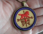 Vintage Girl Scout Horse Weathervane Badge in Antique Gold Pendant Setting 24 Inch Necklace Wearable Textile Artwork