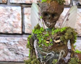 Mummified Tree Fairy, Mummified dog, Glass dome. Dead fairy, fake fairy.