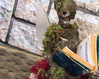 Mummified Book Fairy. Glass dome. Dead fairy, fake fairy.