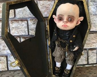 Art Volturi Vampire doll in wooden coffin