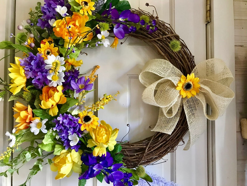 peonies and a burlap bow. Sunshine and Happiness- beautiful bright and sunny this yellow and purple grapevine wreath features sunflowers