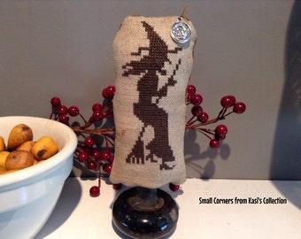 Primitive cross-stitched witch on vintage doorknob