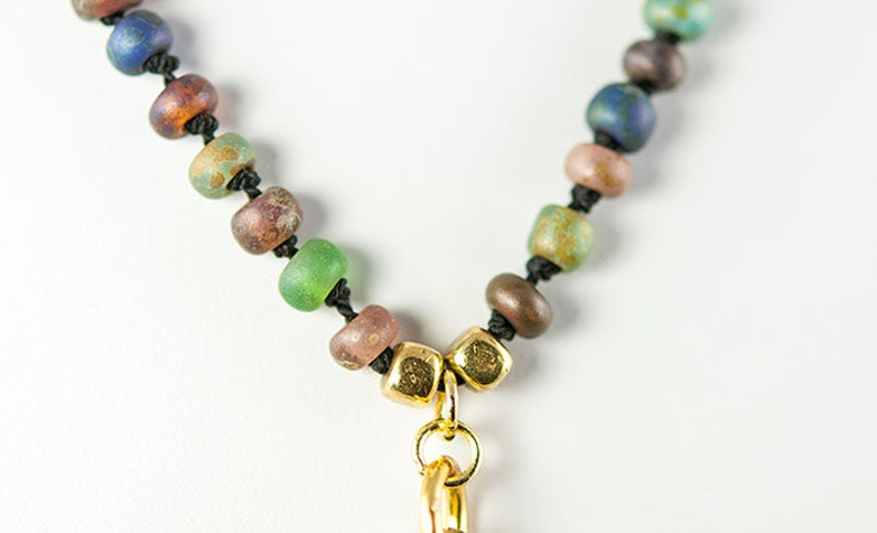 Hand Knotted Silk Necklace with Czech Glass Beads and Metalwork Pendant