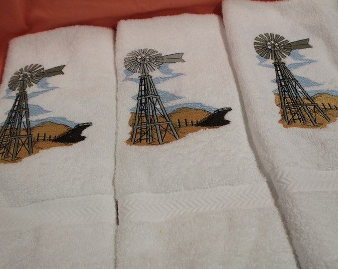 3 white hand towels with windmill and rolling hills