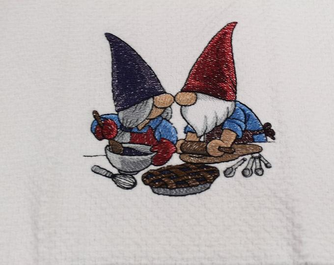 Baking gnomes on white kitchen towel