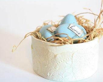 Three Robins Egg Blue Eggs in Nest.  Home Sweet Home.