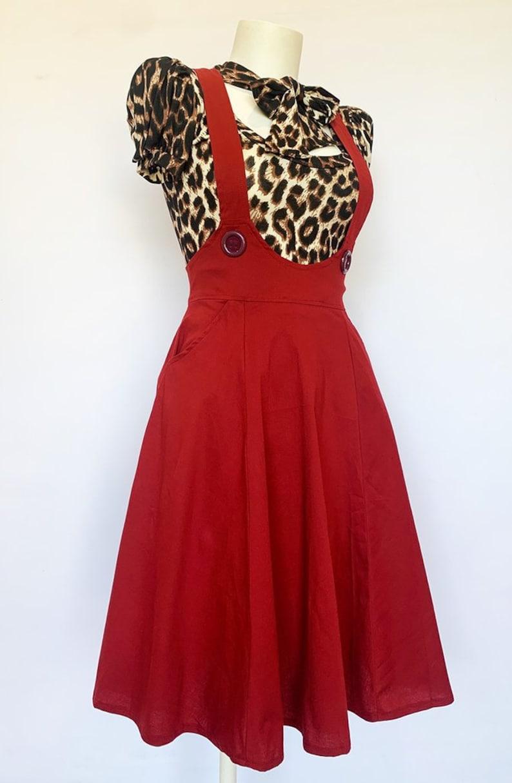 1950s Swing Skirt, Poodle Skirt, Pencil Skirts Dark Red Dolly Pinafore $68.79 AT vintagedancer.com