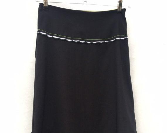 Stretchy black skirt with fringe