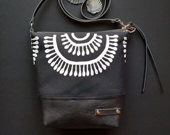 Tribal print canvas and leather cross body bag