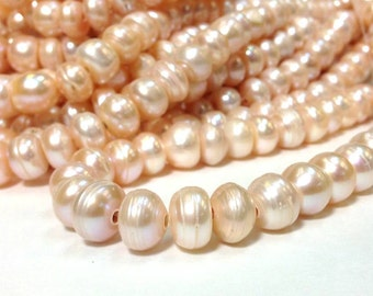 G2315W73 Peach  2.2 mm hole 12 to 13 mm Large Hole Freshwater Pearl Button Beads
