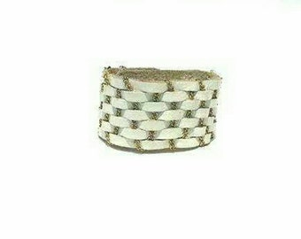 White leather and,gold accented cuff