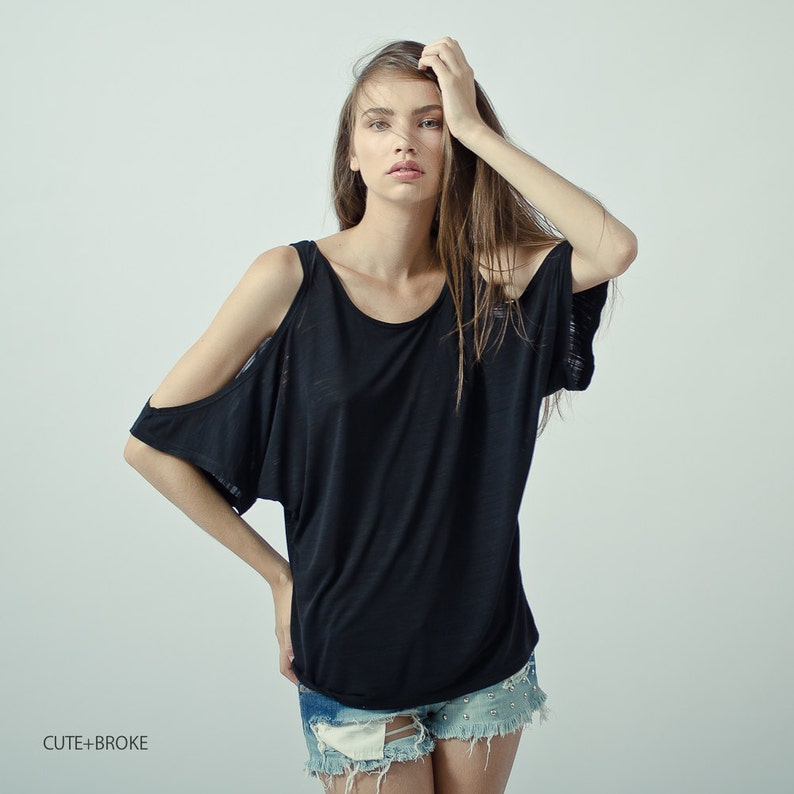 1d7ccc8b4cfeb Black cut out shoulder top oversized open shoulder top