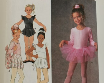 """Sewing Pattern for Child's Tutu, Leotard, Dance Skirts, Bag, Bun Cover and Scrunchie Sizes 5 6 7 8 Chest 24-27"""" (61-69 cm) Simplicity 7351"""