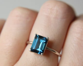 9x7 Emerald Cut London Blue Topaz Ring