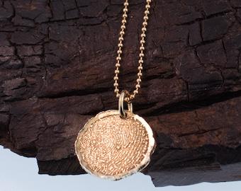 Round Fingerprint shaped Gold Charm.