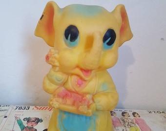 Rare Kitsch Vintage Yellow elephant squeak in apron  flower seller nursery decor squeak toy collectable Edward Mobley Ruth e Newton
