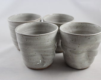 Set of 4 unique pottery wheel thrown stoneware tumblers, dented, handleless cups