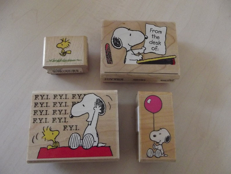 SNOOPY PACKAGE TIE-ONS SET OF FOUR