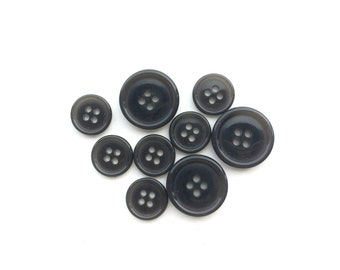 9 Assorted Plastic Grey Buttons
