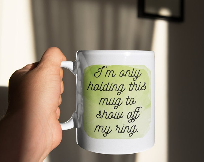 I'm holding this mug to show off my ring Christmas Gift Coffee mug Cocoa Cute engagement gift friend gift for her funny engaged