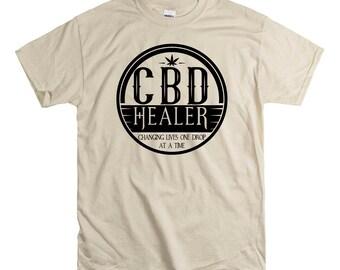 Hemp Healer  Unisex fit Tee CBD Oil Pain Anxiety Hempworx Seller Cannabis Oil one Drop at a time Changing lives Heals Cannabidiol