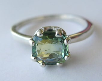 Top-grade Cylon Green Bicolor Sapphire In Sterling Silver Ring, 1.41ct. Size 7.