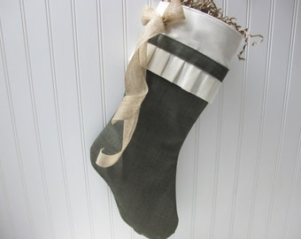 Green stocking with pleated cuff and burlap bow