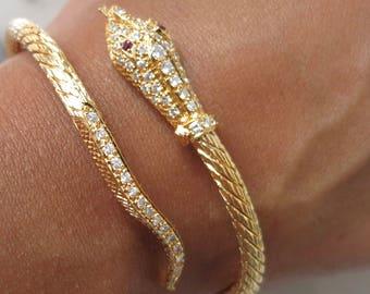22k yellow gold and diamonds flexible bangle.