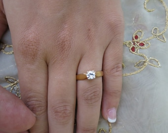 14K Yellow gold single solitaire.