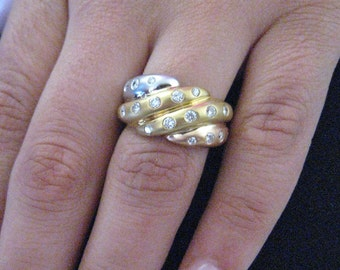 Three tone gold ring with diamonds