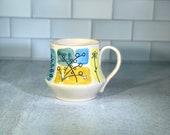 Watercolor Spring Foliage mug // wheel thrown, handmade and carved mug with spring flower detail // spring floral mug - READY TO SHIP